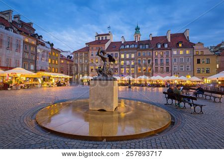 Warsaw, Poland - September 5, 2018: Statue of mermaid in Warsaw old town at dusk, Poland. The Mermaid is a symbol of Warsaw, the capital of Poland.