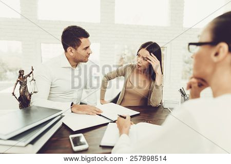 Upset Husband and Angry Wife in Office with Lawyer. Frustrated Husband. Problem in Relationship between People. Modern Law Office. Angry Young Wife. Marriage Problem. Young Advocate. poster