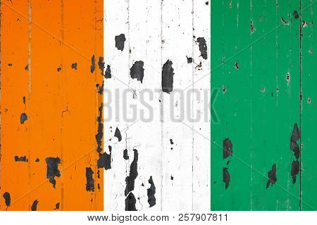 National Flag Of Cote D'ivoire  On The Background Of An Old Mettale Covered With Peeling Paint