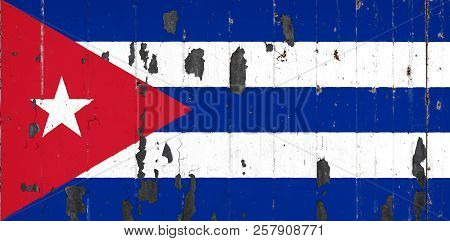 National Flag Of Cuba On The Background Of An Old Mettale Covered With Peeling Paint