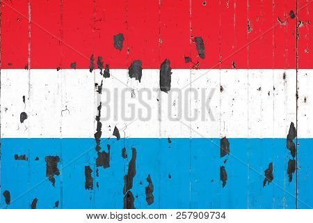 National Flag Of Luxembourg  On The Background Of An Old Mettale Covered With Peeling Paint