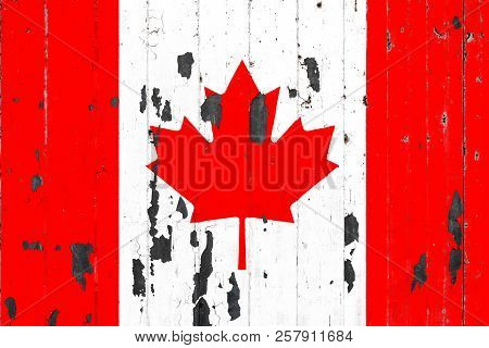 National Flag Of Canada On The Background Of An Old Mettale Covered With Peeling Paint