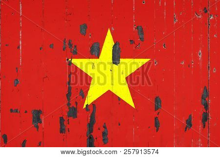 National Flag Of Vietnam On The Background Of An Old Mettale Covered With Peeling Paint