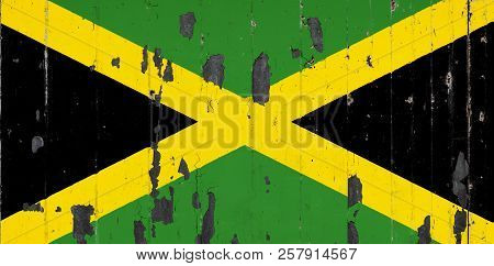 National Flag Of Jamaica On The Background Of An Old Mettale Covered With Peeling Paint