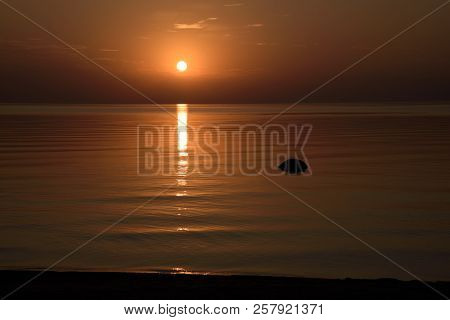 Beautiful Orange Sunset Is Reflected In The Sea.