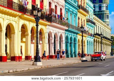 HAVANA,CUBA - SEPTEMBER 5,2018 : Street scene with classic car and colorful buildings in Old Havana