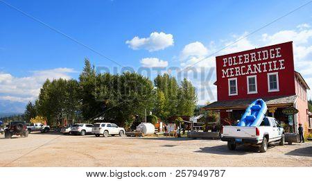 POLEBRIDGE, MONTANA, USA - September 9, 2018: Tourists visit the small ghost town of Polebridge outside the entrance of Glacier National Park