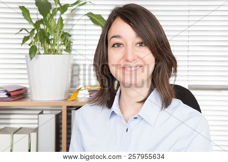 Smiling Business Woman In Office At Working Place