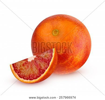 One Bloody Red Orange With A Piece Isolated On White Background With Shadow. The Whole Fruit.