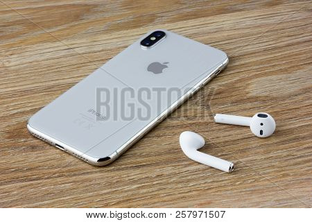 Rostov-on-don, Russia - September 2018: The Iphone 10 Lies On A Wooden Table Next To The Wireless He