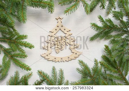 Christmas Background. Green Frame Of Branches Of Christmas Tree On White Wooden Background, Wooden C