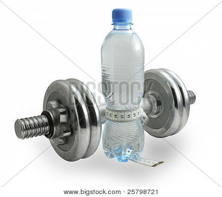 Close-up of bottle of water with a measuring tape around it and chrome dumbbell isolated on white.