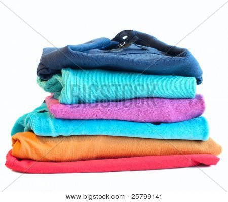 Pile of coloured clothes from the laundry - isolated on white