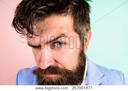 Keep hair tidy and care about hairstyle. Man bearded hipster on strict face pink blue background. Barber tips grooming beard. Hipster guy with messy tousled hair and long beard needs barber service poster