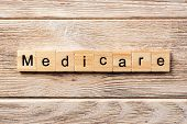 medicare word written on wood block. medicare text on table, concept. poster