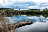 Panoramic view of the lake in the nature reserve Haff Reimech and ornithology center Biodiversum in Remerschen near Schengen, Luxembourg. Nature and bird protection concept. poster