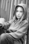 girl in hooded jacket outside poster