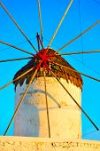 Close-up of old windmill in Mykonos island at sundown, Greece poster
