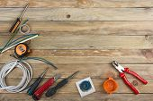 professional repairing implements for decorating and building renovation set on the wooden background, electrician. Electrical tools. Copy space for text. Top view. poster