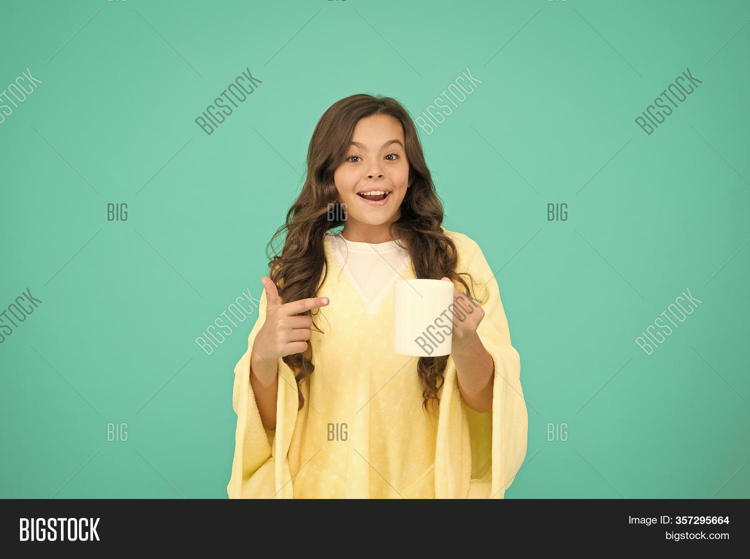 Starting Day With Breakfast. Small Kid Turquoise Background. Little Girl Drink Cocoa Or Milk Before