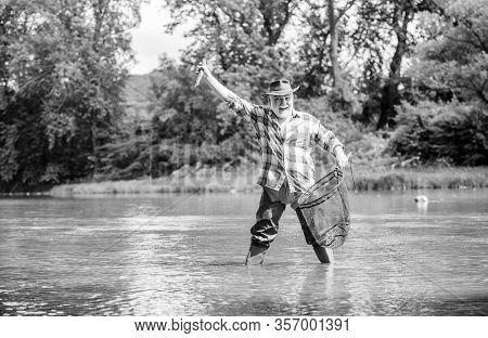 Pensioner Leisure. Man Senior Bearded Fisherman. Hobby Sport Activity. Fish Farming Pisciculture Rai