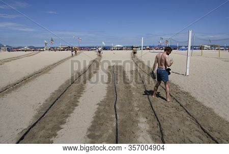 Rio De Janeiro, Brasil-  February 26, 2020: Watering Hot Sand On Paths At Copacabana Beach, Rio De J