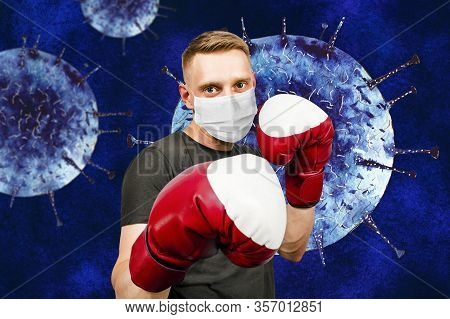 Young Man With Boxing Gloves, Wearing A Protective Face Mask Prevent Virus Infection.