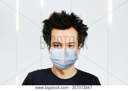Unhappy, Mad Young Man Wearing A Protective Face Mask Prevent Virus Infection Or Pollution