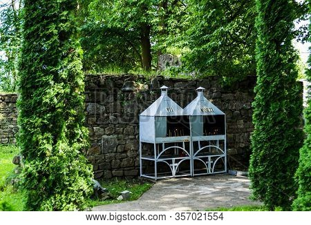 Gura Humorului, Romania - June 19, 2019: The Place Where You Kindle The Candles For Dead Or Living P