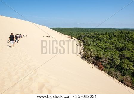 Dune Of Pilat; France - September 10; 2018: People Walking On The Top Of The Dune Of Pilat; The Tall