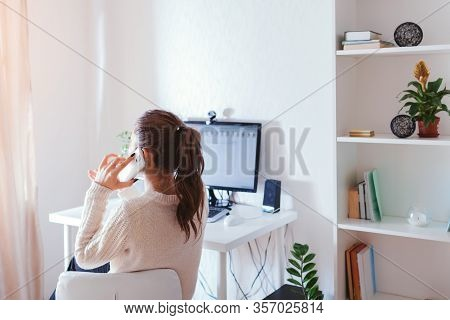 Work From Home During Coromavirus Pandemic. Woman Stays Home. Workspace Of Freelancer. Office Interi