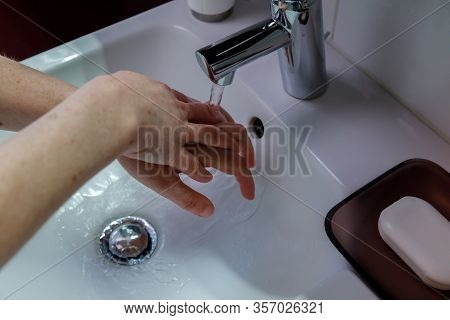 A Woman Washes Her Hands For More Than Twenty Seconds To Prevent The Spread Of Virusses And Bacteria