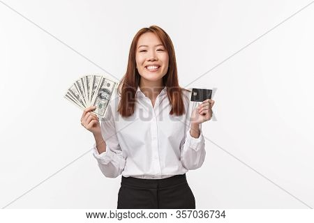 Cheerful And Satisfied Successful Businesswoman Earn Money With Hard Work, Holding Cash With Credit