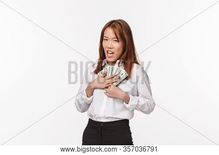 Greedy Young Rich Asian Female In White Shirt, Press Money To Chest And Squinting , Scheming, Stole