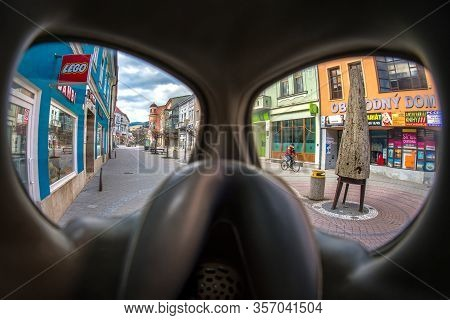 Ruzomberok, Slovakia - March 22: Man With Face Mask On Bike In Empty Town On March 22, 2020 In Ruzom