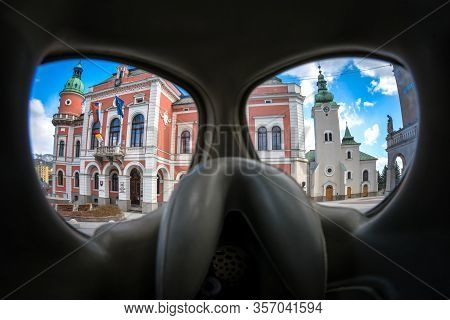 Ruzomberok, Slovakia - March 22: View Through Protective Gas Mask On Town Hall And Church On March 2