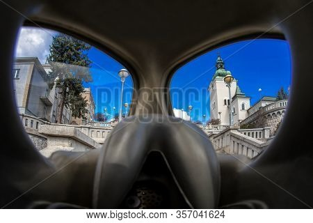 View Through Protective Gas Mask Church In Town Ruzomberok, Slovakia. Coronavirus. Covid-19 Concept