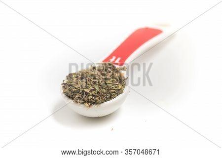 Dried Oregano Into A Teaspoon