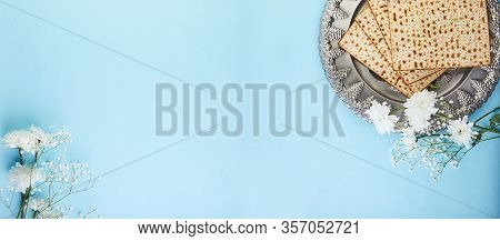 Pesah Celebration Concept - Jewish Passover Holiday Background Matzo And Seder Plate With White Flow