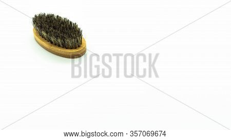 Beard Brush Made Of Bamboo On A White Background On The Left Of The Image With Space On The Right. C