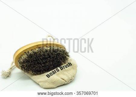 Beard Brush With Natural Bristles, On Its Case Located On The Left Of The Image With White Backgroun