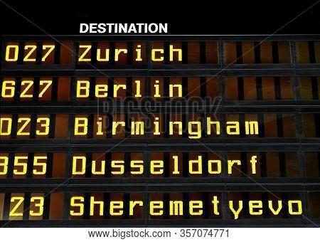 Airport Departures Board With The Destinations Zurich, Berlin, Birmingham, Dusseldorf And Moscow Sch