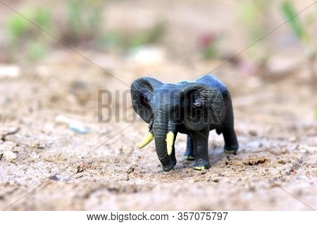 Elephant Walking On Sandy Soil. A Toy Model Of An Elefant