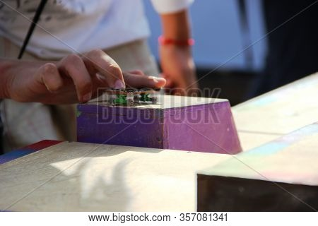 Teens Hand Playing The Fingerboard, Close-up. Fingerboard Competitions, Freestyle And Hurdles.