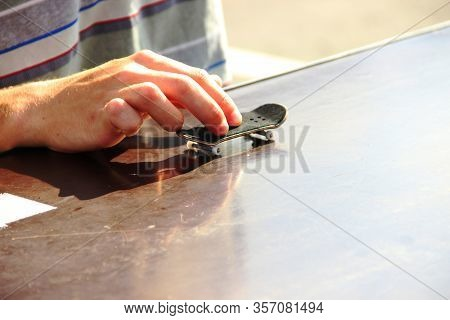 Teenagers Hand Playing The Fingerboard, Close-up. Fingerboard Competitions, Freestyle And Hurdles. F