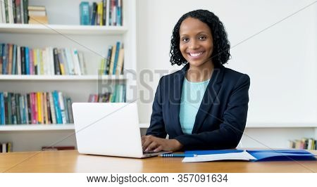 Laughing African American Businesswoman Working At Computer At Homeoffice To Stay At Home
