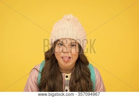 Ugh, Yuck. Little Schoolchild Stick Tongue. Little Kid Make Grimace Yellow Background. Little Girl B