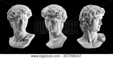 Gypsum Statue Of Davids Head. Michelangelos David Statue Plaster Copy Isolated On Black Background.