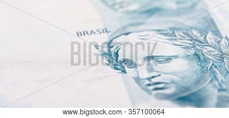 Details Of 100 Reais Banknote From Brazil, With Selective Focus, Background Image For Monetary Conce