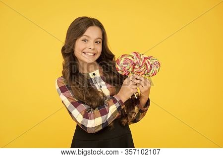 Sugar Addiction. Happy Kid With Sweet Candy. Kid Child Holding Lollipops Candy Yellow Background. Br